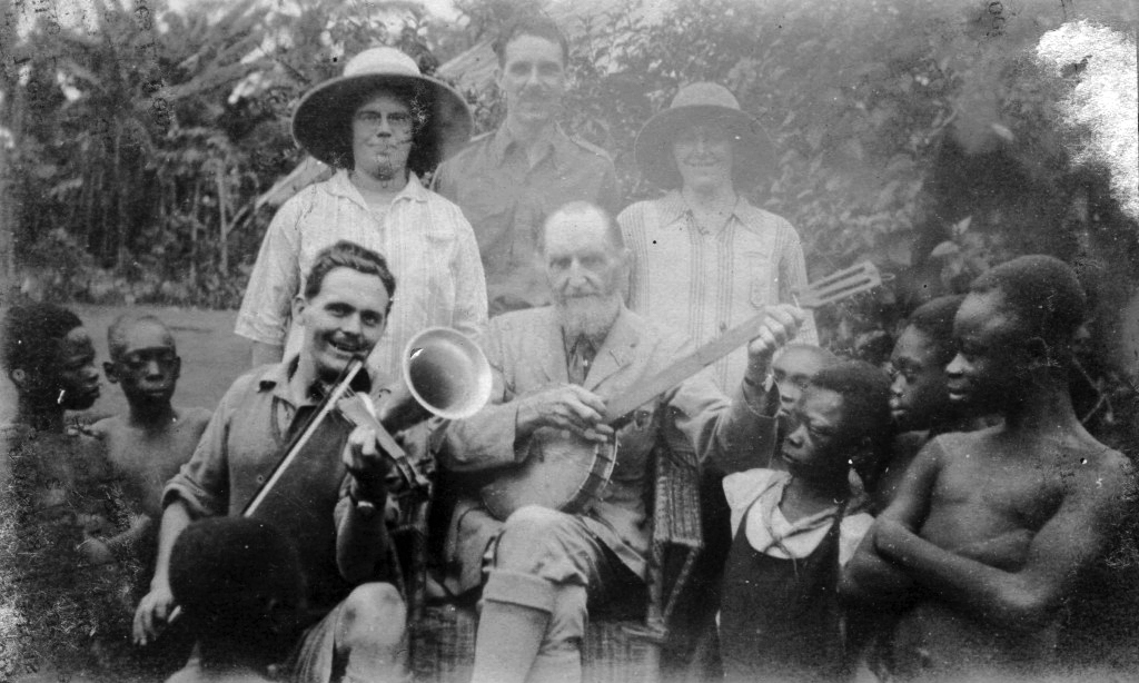 Studd with a banjo and choir