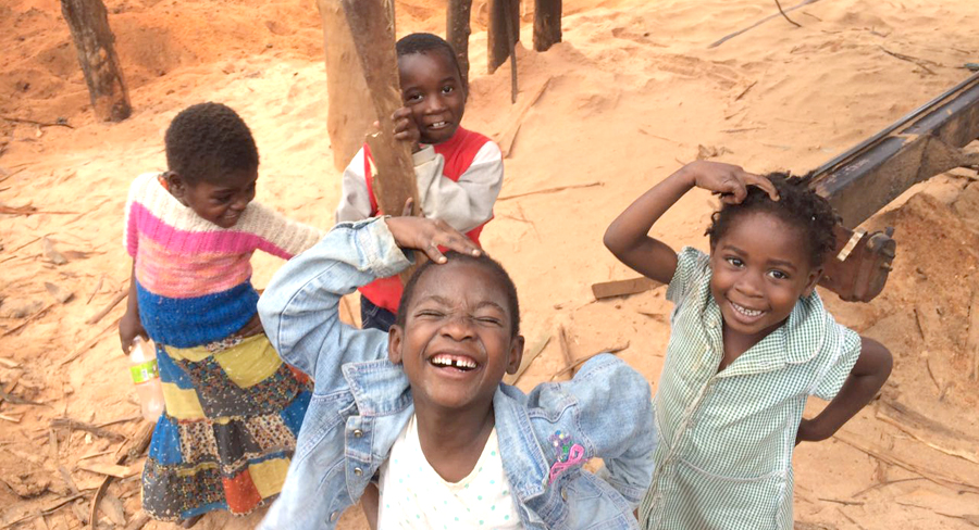 Children pose for the camera at the Maforga Sawmill